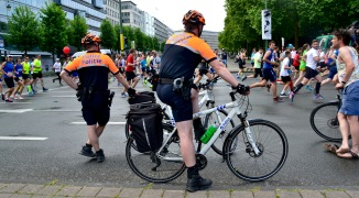 Barry Sandland/TIMB - Two bicycle police officers watching the Brussels 20km run