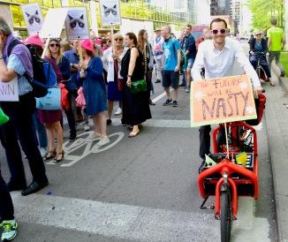 Barry Sandland/TMB - Man n a Bllt card bike caring an ant-rp per