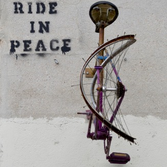 ©Barry Sandland/TIMB - Art mural of broken bicycle on Paris wall by Rest In Peace