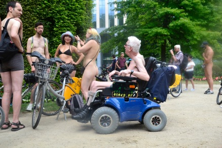 ©Barry Sandland/TIMB - Man in an electric wheelchair at the World Nude Bike Ride in Brussels