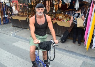 ©Barry Sandland/TIMB - Man on a folding bike at a market in Brussels