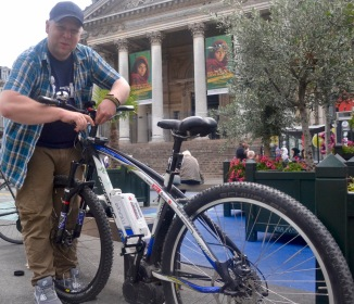 ©Barry Sandland/TIMB - Cyclist with his electric mountain bike in the city centre.