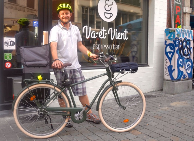 ©Barry Sandland/TIMB - Va et Vient café owner w his cargo bike in front of his café.