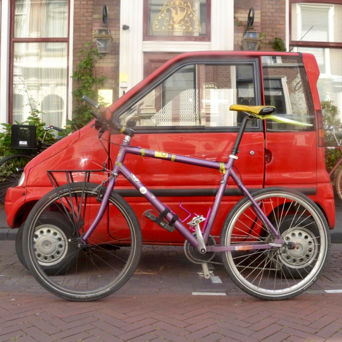 ©Barry Sandland/TIMB - Bicycle alongside a Canta mobility car, demonstrating the short length