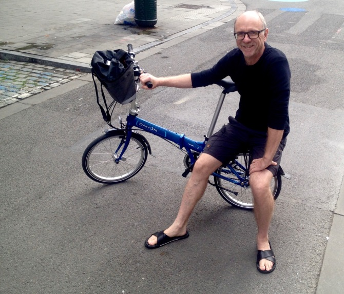 ©Barry Sandland/TIMB - Cyclist with his folding Dahon bike that was not stolen. We stopped the thief in the act.
