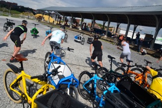 ©Barry Sandland/TIMB - Start of the cargo bike race heats as riders run to their bikes