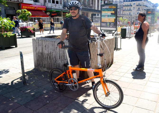 ©Barry Sandland/TIMB - Cyclist w his folding Ahooga in the city centre of Brussels