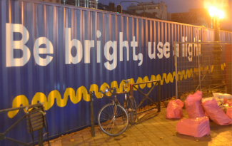 ©Barry Sandland/TIMB - Cycling advocacy groups set up a part of containers as as tunnel for their Be Bright Use a Light campaign